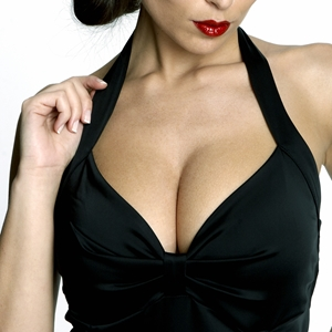 If you have very large breasts, dress to emphasize your waistline.